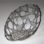 Cocoon, stainless steel fine wire stress skin form with glass spheres by Ema Tanigaki
